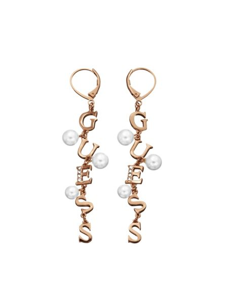 Young contrasts gold plated pearls earrings.